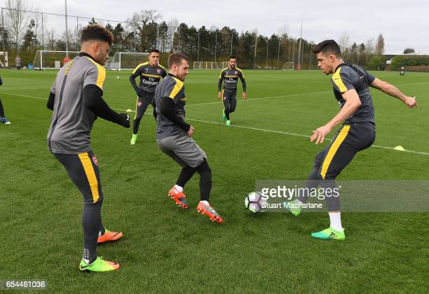 Alex OxladeChamberlain Aaron Ramsey and Gabriel of Arsenal during a training session at London Colney on March 17 2017 in St Albans England