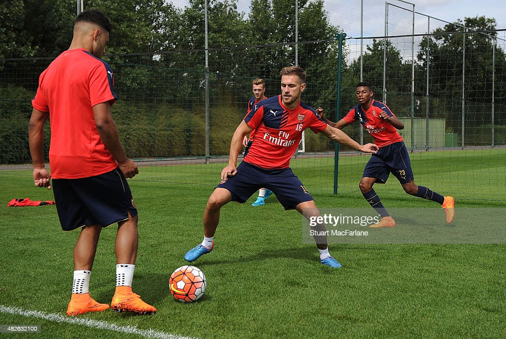 Alex Oxlade-Chamberlain and Aaron Ramsey of Arsenal during a training session at London Colney on August 1, 2015 in St Albans, England.