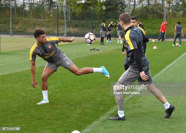Alex OxladeChamberlain and Aaron Ramsey of Arsenal during a training session at London Colney on April 22 2017 in St Albans England