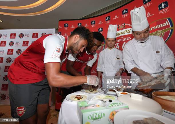 Alex OxladeChamberlain and Alex Iwobi of Arsenal takes part in a chinese cooking event for Emirates on July 21 2017 in Beijing China