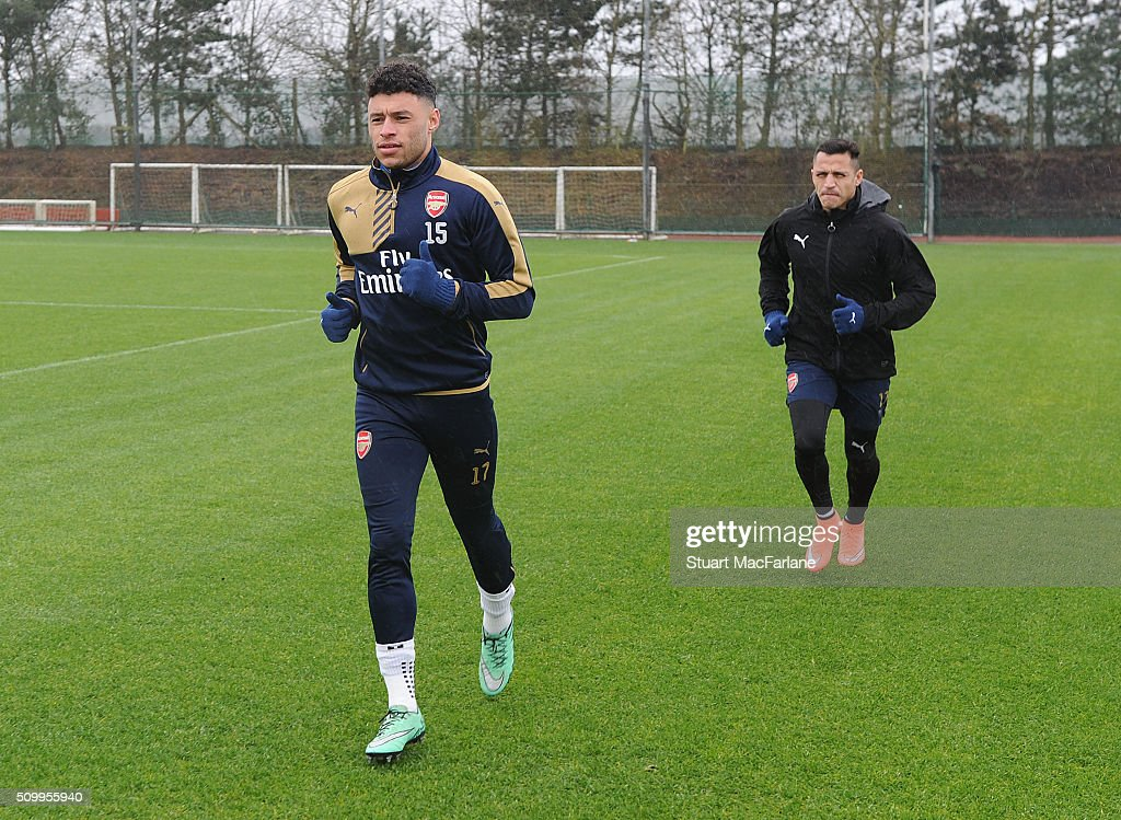<a gi-track='captionPersonalityLinkClicked' href=/galleries/search?phrase=Alex+Oxlade-Chamberlain&family=editorial&specificpeople=7191518 ng-click='$event.stopPropagation()'>Alex Oxlade-Chamberlain</a> and <a gi-track='captionPersonalityLinkClicked' href=/galleries/search?phrase=Alexis+Sanchez&family=editorial&specificpeople=5515162 ng-click='$event.stopPropagation()'>Alexis Sanchez</a> of Arsenal during a training session at London Colney on February 13, 2016 in St Albans, England.