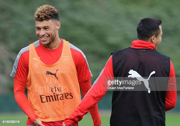 Alex OxladeChamberlain and Alexis Sanchez of Arsenal during a training session at London Colney on October 21 2016 in St Albans England