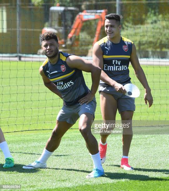 Alex OxladeChamberlain and Alexis Sanchez of Arsenal during a training session at London Colney on May 26 2017 in St Albans England