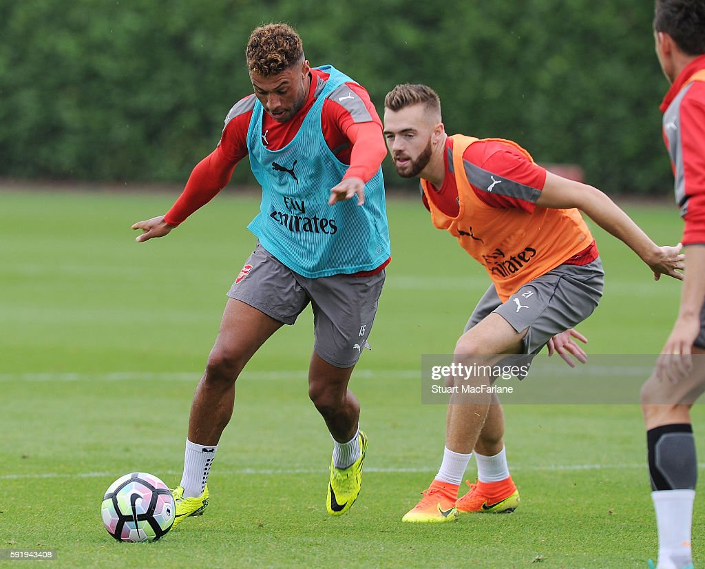 Alex OxladeChamberlain and Calum Chambers of Arsenal during a training session at London Colney on August 19 2016 in St Albans England