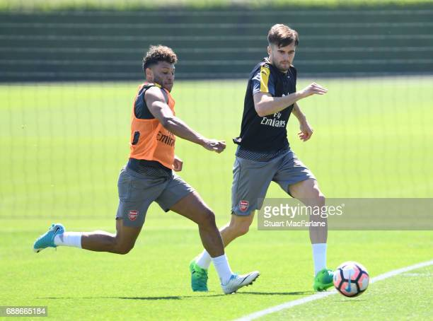 Alex OxladeChamberlain and Carl Jenkinson of Arsenal during a training session at London Colney on May 26 2017 in St Albans England