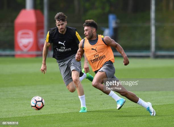 Alex OxladeChamberlain and Carl Jenkinson of Arsenal during the Arsenal Training Session at London Colney on May 24 2017 in St Albans England