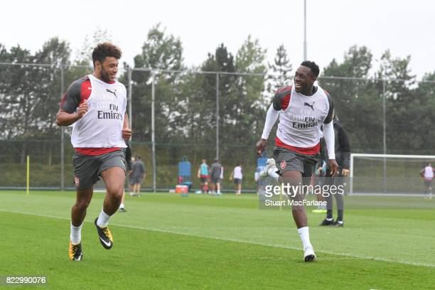 Alex OxladeChamberlain and Danny Welbeck of Arsenal during a training session at London Colney on July 26 2017 in St Albans England
