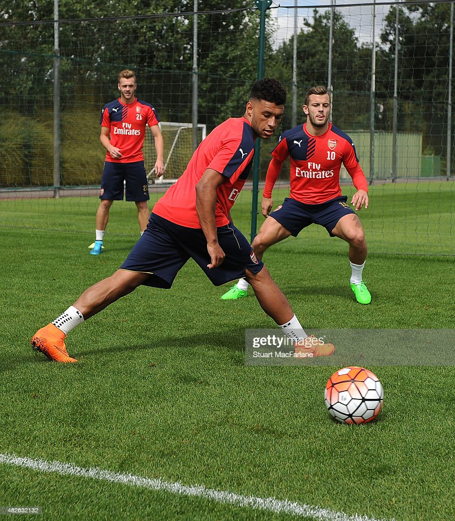 Alex Oxlade-Chamberlain and Jack Wilshere of Arsenal during a training session at London Colney on August 1, 2015 in St Albans, England.