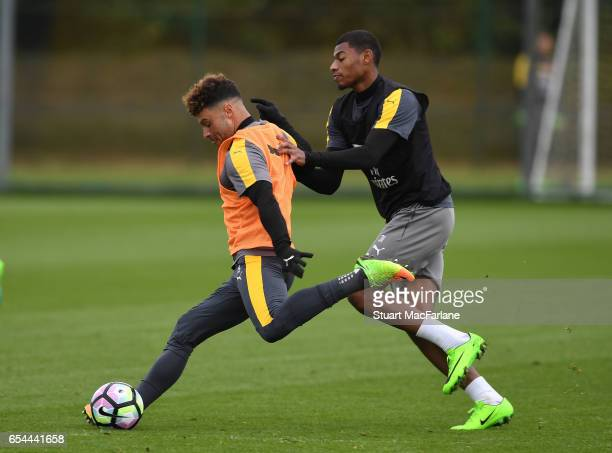 Alex OxladeChamberlain and Jeff ReineAdelaide of Arsenal during a training session at London Colney on March 17 2017 in St Albans England