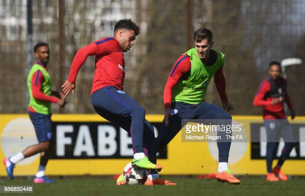 Alex OxladeChamberlain and John Stones of England in action during an England training session on March 23 2017 in Bochum Germany England are due to...