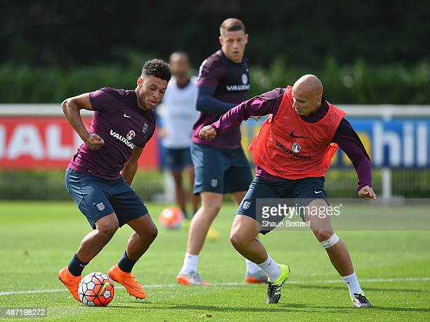 Alex OxladeChamberlain and Jonjo Shelvey of England during a training session at Tottenham Hotspur Training Centre on September 7 2015 in Enfield...