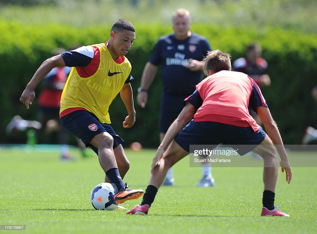 <a gi-track='captionPersonalityLinkClicked' href=/galleries/search?phrase=Alex+Oxlade-Chamberlain&family=editorial&specificpeople=7191518 ng-click='$event.stopPropagation()'>Alex Oxlade-Chamberlain</a> and Kriss Olsson of Arsenal during a training session at London Colney on July 09, 2013 in St Albans, England.