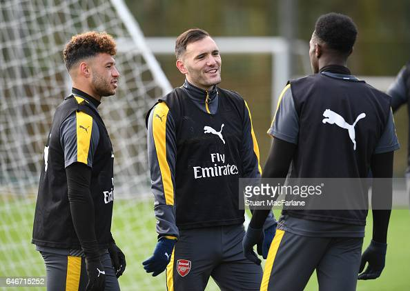 Alex OxladeChamberlain and Lucas Perez of Arsenal during a training session at London Colney on March 1 2017 in St Albans England