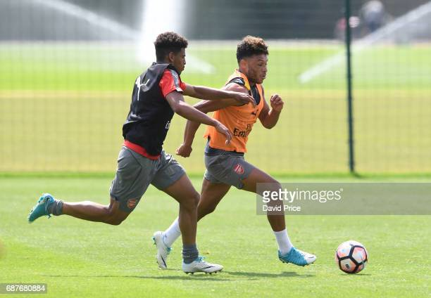Alex OxladeChamberlain and Marcus McGuane of Arsenal during the Arsenal Training Session at London Colney on May 24 2017 in St Albans England
