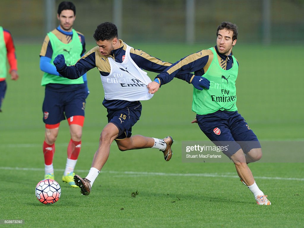 Alex OxladeChamberlain and Mathieu Flamini of Arsenal during a training session at London Colney on January 8 2016 in St Albans England