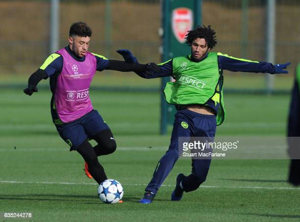 Alex OxladeChamberlain and Mohamed Elneny of Arsenal during a training session at London Colney on February 13 2017 in St Albans England