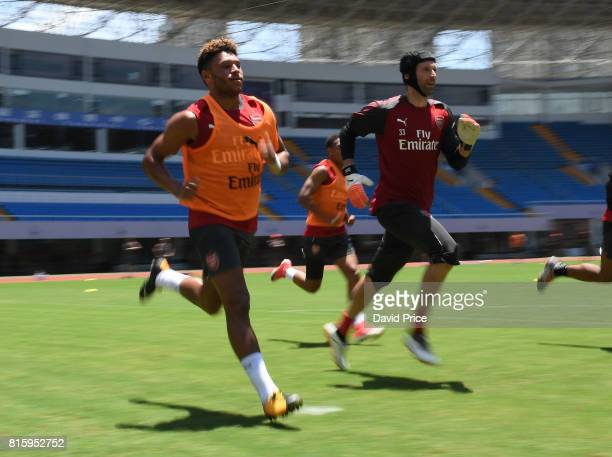 Alex OxladeChamberlain and Petr Cech of Arsenal during an Arsenal Training Session at Yuanshen Sports Centre Stadium on July 17 2017 in Shanghai China