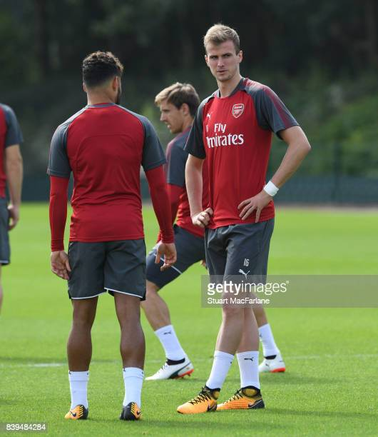 Alex OxladeChamberlain and Rob Holding of Arsenal during a training session at London Colney on August 26 2017 in St Albans England