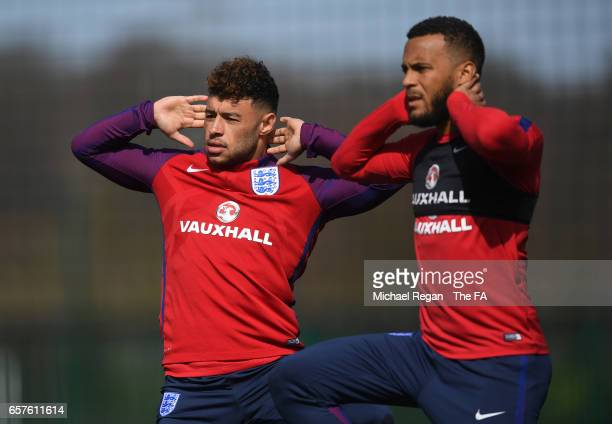 Alex OxladeChamberlain and Ryan Bertrand warm up during the England training session at the Tottenham Hotspur Training Centre on March 25 2017 in...