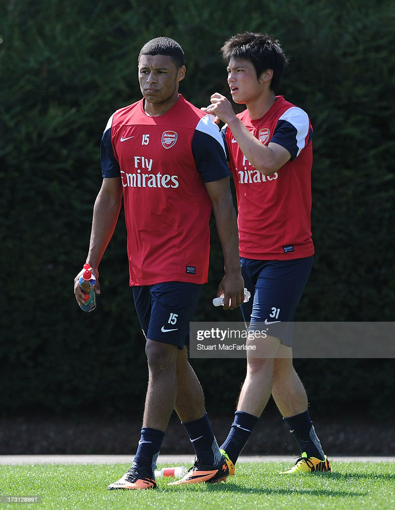 Alex Oxlade-Chamberlain and Ryo Miyaichi of Arsenal look on during a training session at London Colney on July 08, 2013 in St Albans, England.