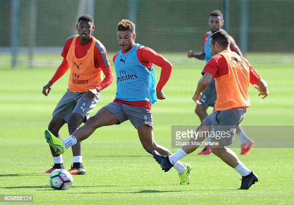 Alex OxladeChamberlain and Santi Cazorla of Arsenal during a training session at London Colney on September 23 2016 in St Albans England