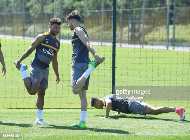 Alex OxladeChamberlain Carl Jenkinson and Alexis Sanchez of Arsenal during a training session at London Colney on May 26 2017 in St Albans England