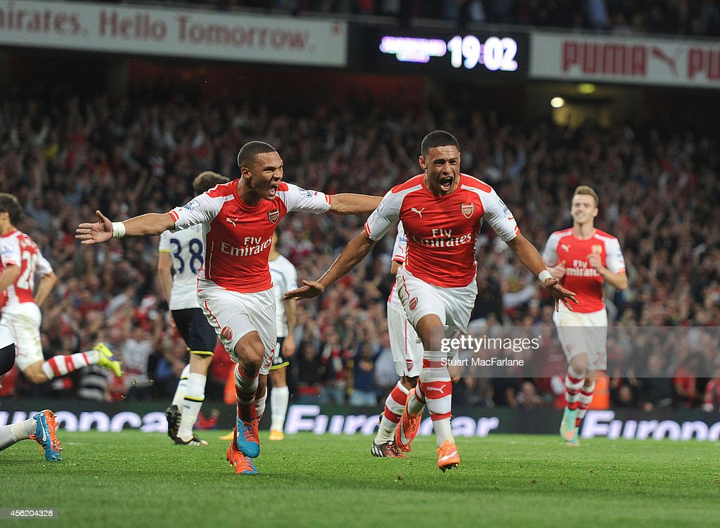 Alex Oxlade-Chamberlain celebrates scoring for Arsenal with (L) Kieran Gibbs during the Barclays Premier League match between Arsenal and Tottenham at Emirates Stadium on September 27, 2014 in London, England.