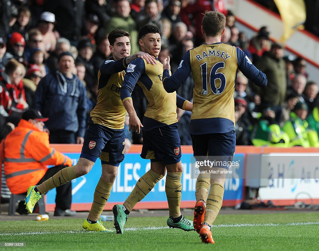 <a gi-track='captionPersonalityLinkClicked' href=/galleries/search?phrase=Alex+Oxlade-Chamberlain&family=editorial&specificpeople=7191518 ng-click='$event.stopPropagation()'>Alex Oxlade-Chamberlain</a> celebrates scoring the 2nd Arsenal goal with (L) Hector Bellerin and (R) <a gi-track='captionPersonalityLinkClicked' href=/galleries/search?phrase=Aaron+Ramsey&family=editorial&specificpeople=4784114 ng-click='$event.stopPropagation()'>Aaron Ramsey</a> during the Barclays Premier League match between AFC Bournemouth and Arsenal at The Vitality Stadium on February 7, 2016 in Bournemouth, England. (Photo by Stuart MacFarlane/Arsenal FC via Getty Images