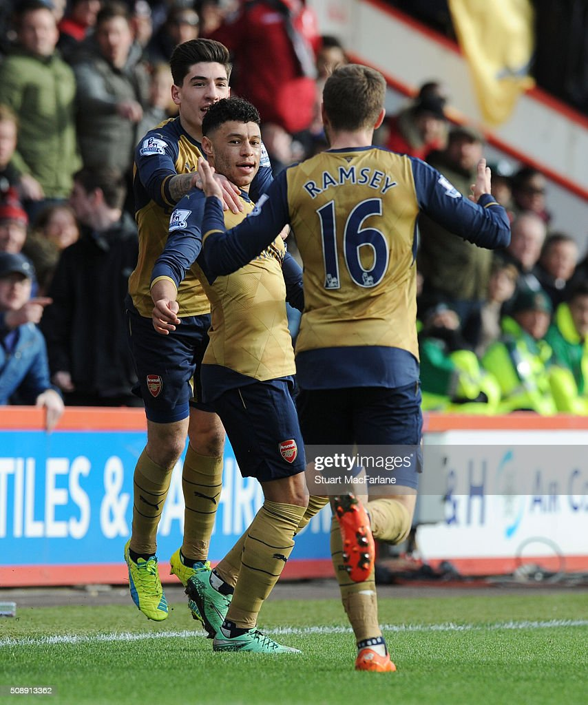<a gi-track='captionPersonalityLinkClicked' href=/galleries/search?phrase=Alex+Oxlade-Chamberlain&family=editorial&specificpeople=7191518 ng-click='$event.stopPropagation()'>Alex Oxlade-Chamberlain</a> celebrates scoring the 2nd Arsenal goal with (L) Hector Bellerin and (R) <a gi-track='captionPersonalityLinkClicked' href=/galleries/search?phrase=Aaron+Ramsey&family=editorial&specificpeople=4784114 ng-click='$event.stopPropagation()'>Aaron Ramsey</a> during the Barclays Premier League match between AFC Bournemouth and Arsenal at The Vitality Stadium on February 7, 2016 in Bournemouth, England.