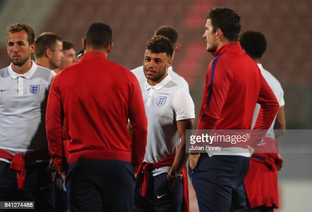 Alex OxladeChamberlain in discussion with England team mates as they inspect the pitch on the eve of the World Cup qualifying match against Malta at...