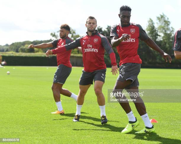Alex OxladeChamberlain Jack Wilshere and Danny Welbeck of Arsenal during a training session at London Colney on August 18 2017 in St Albans England