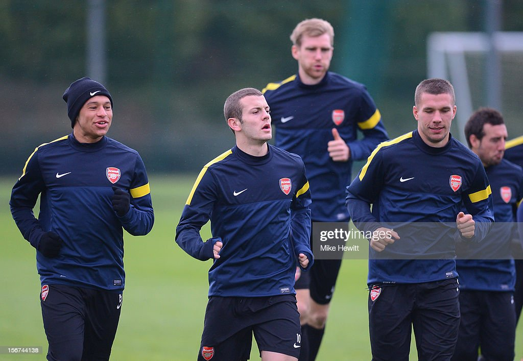 Alex Oxlade-Chamberlain, Jack Wilshere, Per Mertesacker and Lukas Podolski of Arsenal in action during a training session at London Colney ahead of tomorrow's UEFA Champions League Group B match against Montpellier on November 20, 2012 in St Albans, England.
