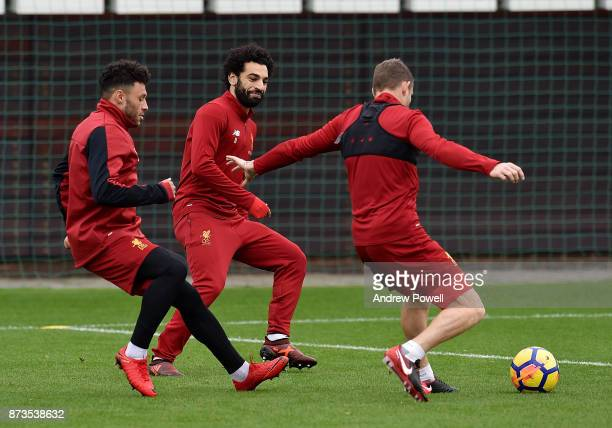 Alex OxladeChamberlain Mohamed Salah and James Milner of Liverpool during a training session at Melwood Training Ground on November 13 2017 in...