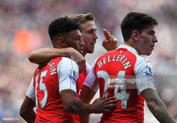 Alex OxladeChamberlain Nacho Monreal and Hector Bellerin of Arsenal celebrates their team's first goal scored by Fabricio Coloccini of Newcastle...