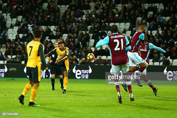 Alex OxladeChamberlain of Arsena scores his team's fourth goal during the Premier League match between West Ham United and Arsenal at London Stadium...