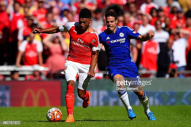 Alex OxladeChamberlain of Arsenal and Cesar Azpilicueta of Chelsea compete for the ball during the FA Community Shield match between Chelsea and...