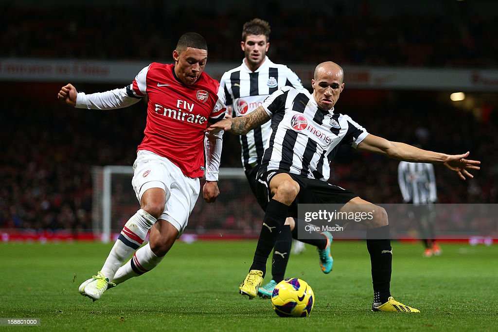 Alex Oxlade-Chamberlain of Arsenal and Gabriel Obertan of Newcastle United battle for the ball during the Barclays Premier League match between Arsenal and Newcastle United at the Emirates Stadium on December 29, 2012 in London, England.