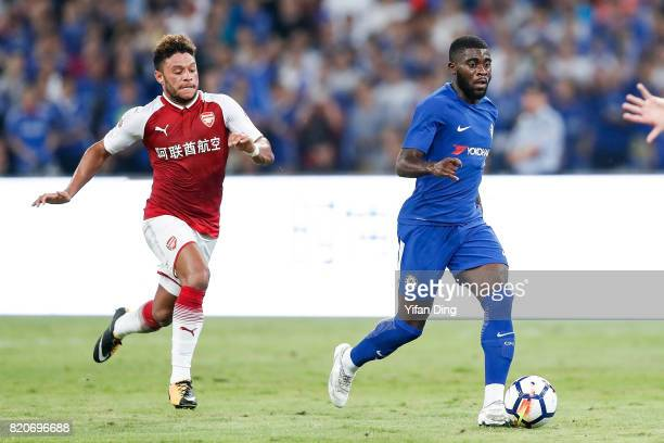 Alex OxladeChamberlain of Arsenal and Jeremie Boga of Chelsea react during the PreSeason Friendly match between Arsenal FC and Chelsea FC at Birds...