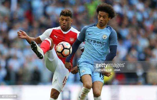 Alex OxladeChamberlain of Arsenal and Leroy Sane of Manchester City during the Emirates FA Cup semifinal match between Arsenal and Manchester City at...