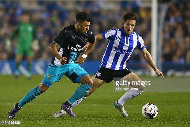 Alex OxladeChamberlain of Arsenal and Sam Hutchinson of Sheffield Wednesday compete for the ball during the Capital One Cup fourth round match...