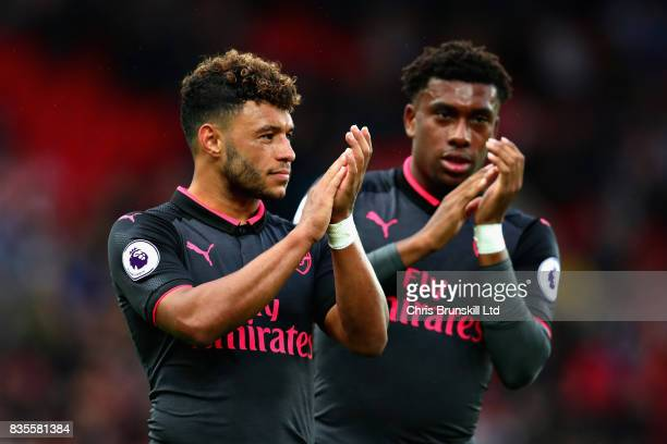 Alex OxladeChamberlain of Arsenal and teammate Alex Iwobi look dejected following the Premier League match between Stoke City and Arsenal at Bet365...