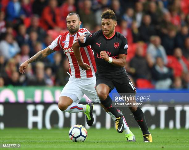 Alex OxladeChamberlain of Arsenal breaks past Jese of Stoke during the Premier League match between Stoke City and Arsenal at Bet365 Stadium on...
