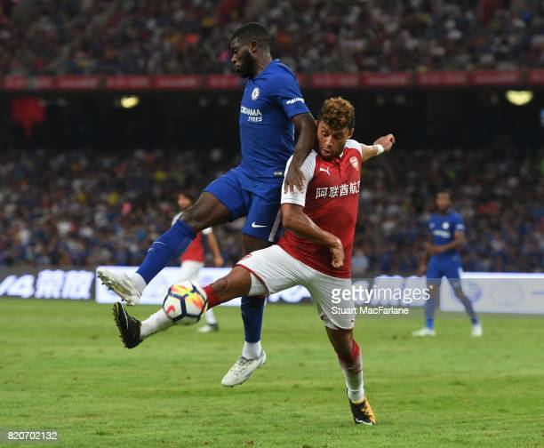 Alex OxladeChamberlain of Arsenal callenged by Jeremie Boga of Chelsea during the pre season friendly between Arsenal and Chelsea at the Birds Nest...