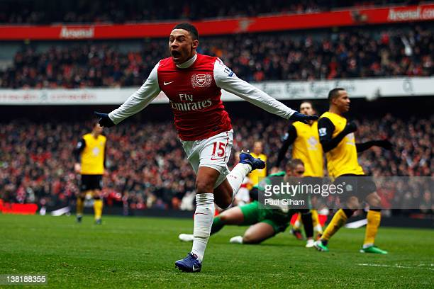 Alex OxladeChamberlain of Arsenal celebrates after he scored their third goal during the Barclays Premier League match between Arsenal and Blackburn...