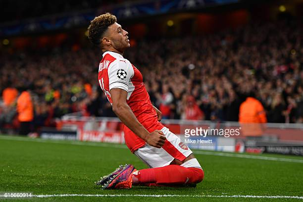 Alex OxladeChamberlain of Arsenal celebrates after scoring his team's third goal of the game during the UEFA Champions League group A match between...