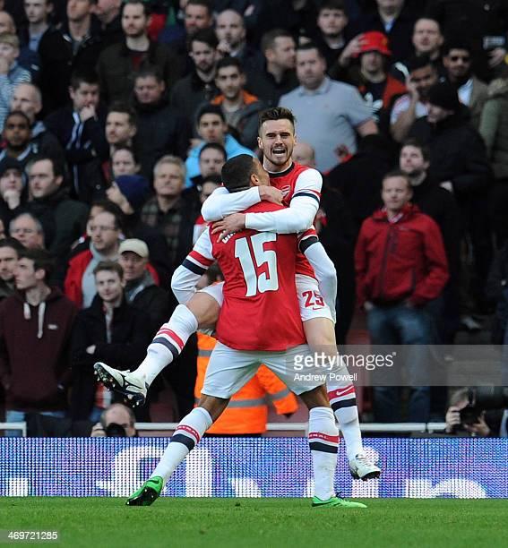 Alex OxladeChamberlain of Arsenal celebrates after scoring the opening goal during the FA Cup Fifth Round match between Arsenal and Liverpool at...