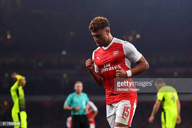 Alex OxladeChamberlain of Arsenal celebrates scoring his sides first goal during the EFL Cup fourth round match between Arsenal and Reading at...