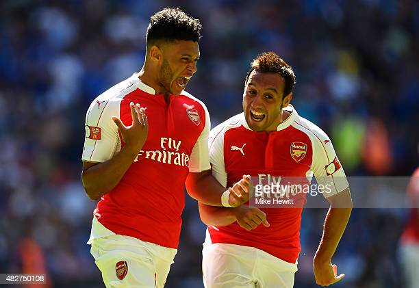 Alex OxladeChamberlain of Arsenal celebrates scoring his team's first goal with his team mates Santi Cazorla during the FA Community Shield match...