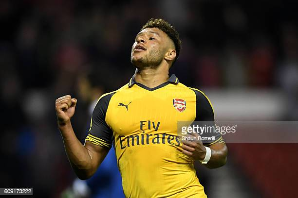 Alex OxladeChamberlain of Arsenal celebrates scoring his team's fourth goal during the EFL Cup Third Round match between Nottingham Forest and...