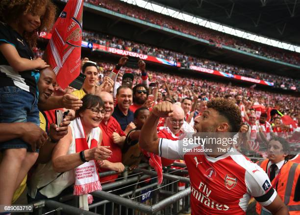 Alex OxladeChamberlain of Arsenal celebrates with fans after the Emirates FA Cup Final between Arsenal and Chelsea at Wembley Stadium on May 27 2017...